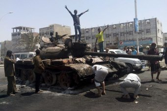 A burnt out tank in Yemen's southern port city of Aden on March 29.