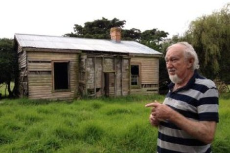 Len Sullivan shows the remnants of the house built by his father, Clifford Sullivan, on the family property.