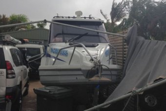 The carport collapsed onto the  boat