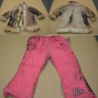Clothing found in dumped suitcase