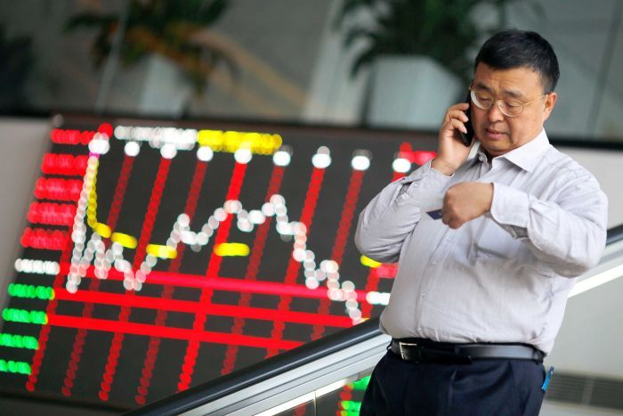 Chinese investor on the phone as market falls