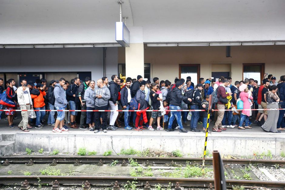 Migrants arrive at a railway station in Vienna, Austria