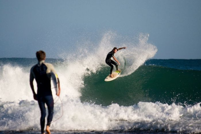 Surfers catch waves at Kalbarri