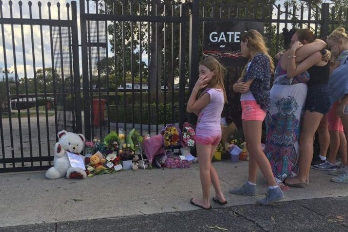 Mourners place flowers and toys outside Marsden State High School