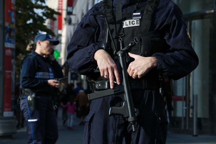 Armed French police stand guard