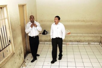 Myuran Sukumaran and Andrew Chan wait in a holding cell at Denpasar Court.