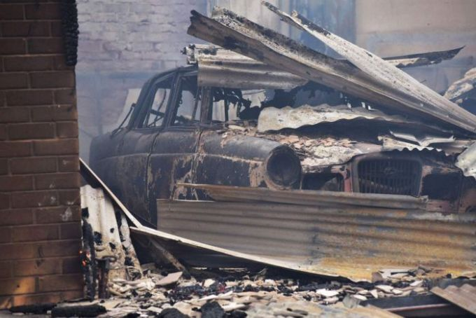 Car burnt out after a bushfire passed through