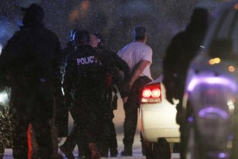 The handcuffed suspected gunman at the Planned Parenthood clinic.