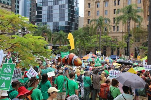 Thousands gather in Queen's Park for a climate action rally through Brisbane.
