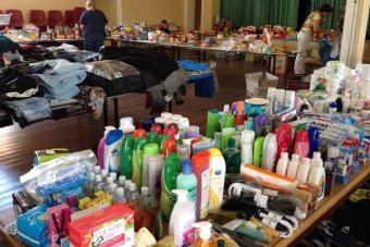 Tables are filled with house hold item donated by the community.