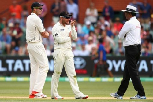 Brendon McCullum talks to the umpire