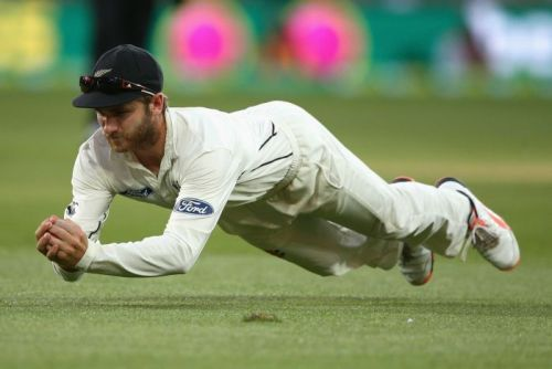 Kane Williamson dives to take a catch