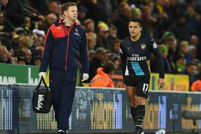 An injured Alexis Sanchez leaves the pitch in Arsenal's 1-1 draw with Norwich on November 29, 2015.