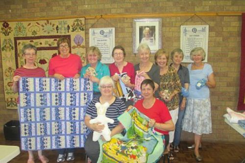 The Samford Charity Craft Group with their handmade items.