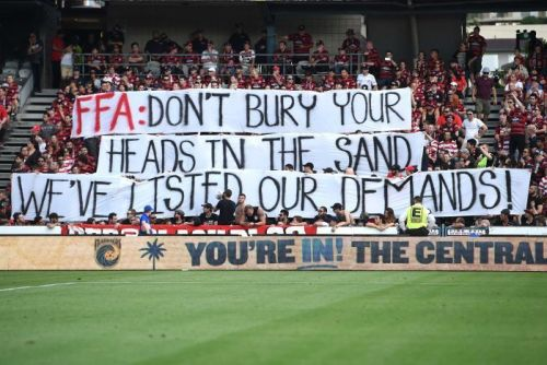 Wanderers fans hold a banner before walking out in protest over the names of banned spectators being published in a newspaper.
