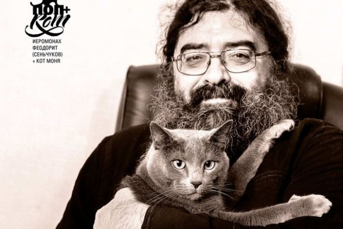 A russian priest with his cat.