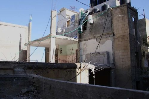 The destroyed home belonging to the family of alleged Hamas member Ibrahim al-Akari