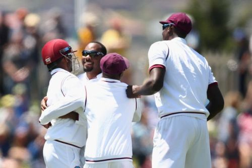 The West Indies celebrate a Jomel Warrican wicket