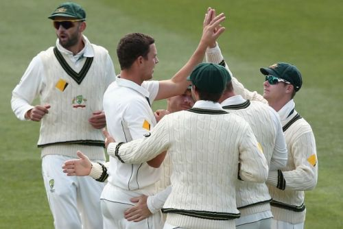 Josh Hazlewood celebrates the wicket of Kemar Roach on day three