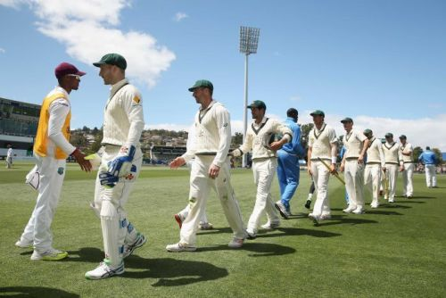 Teams shake hands after Australia's win over West Indies
