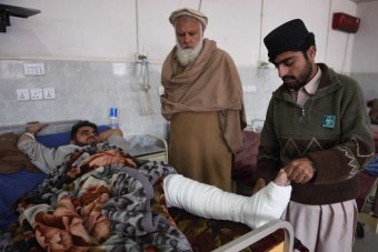 Pakistani relatives tend to an earthquake survivor