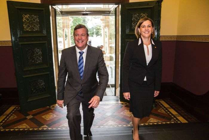 Tim Nicholls and his deputy Deb Frecklington walk down a corridor.