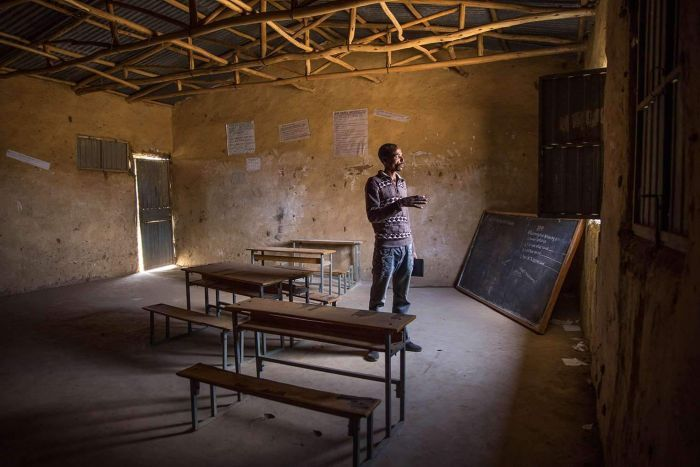 Teacher at empty schoolroom in Ethiopia