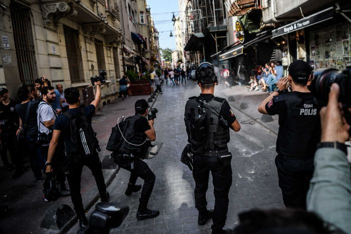 Turkish riot police officers fire rubber bullets to disperse LGBT protesters.