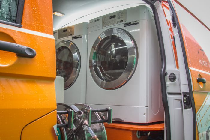 Each van holds two washing machines and two clothes dryers.