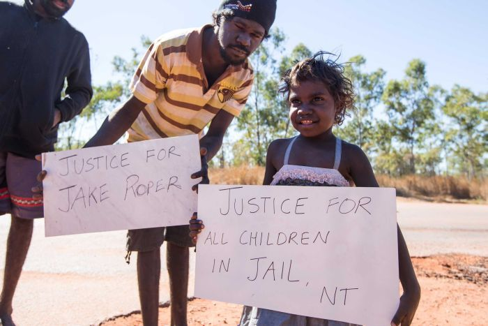 A child is among the protesters in Borroloola, NT, campaigning for justice for youth detainees.