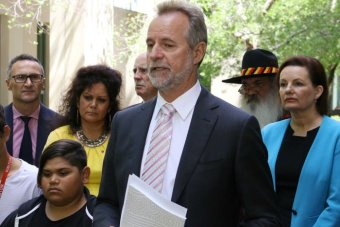 Nigel Scullion talks at a press conference.