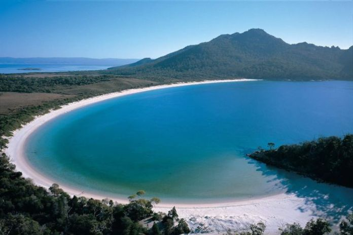 Blue skies over Wineglass Bay in Freycinet National Park on Tasmania's east coast,