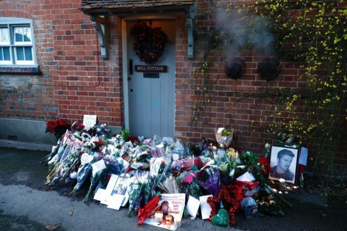Tributes are seen outside the house of singer George Michael, called Mill Cottage.