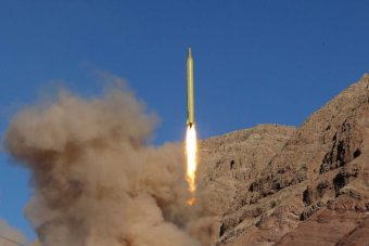 A ballistic missile is launched and tested in an remote looking and undisclosed location in Iran.