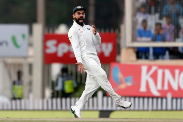 Virat Kohli carries on after David Warner's wicket