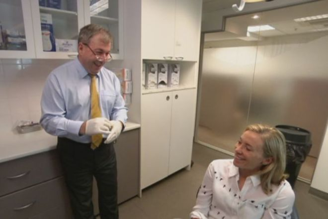 Dr George Dimitroulis talks with Susie Robinson after surgery