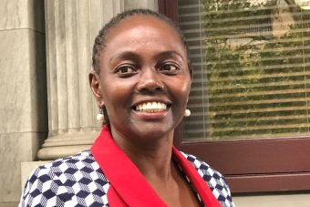 Family First senator elect Lucy Gichuhi smiles.