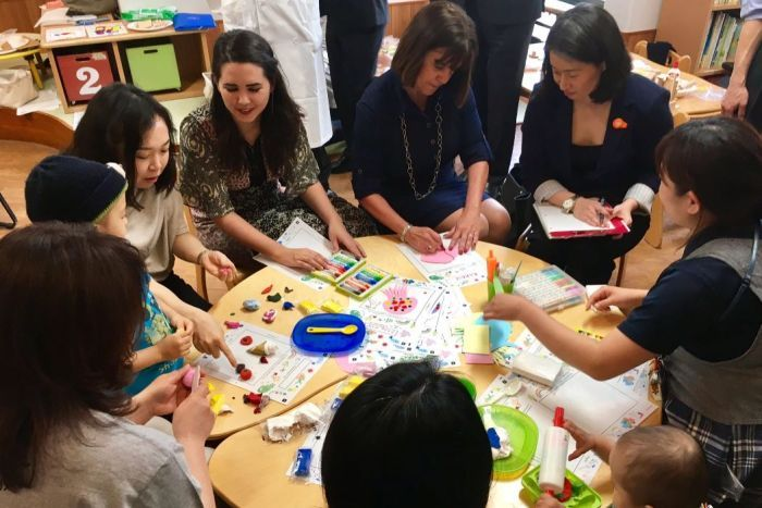 Karen Pence engages in an art therapy session at a local hospital in Tokyo during her husband's tour of Asia.