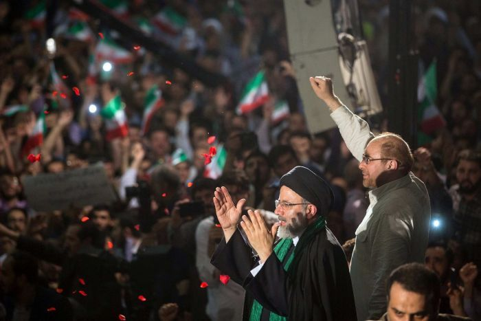 Iranian presidential candidate Ebrahim Raisi with Tehran Mayor Mohammad Baqer Qalibaf during a campaign meeting.