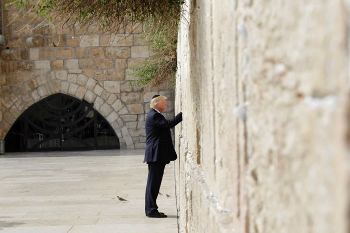 US President Donald Trump touches the Western Wall, Judaism's holiest prayer site.