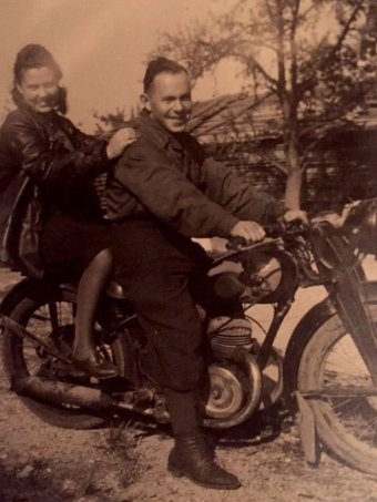 Phillip and Bella on a motorcycle in a 1940s.