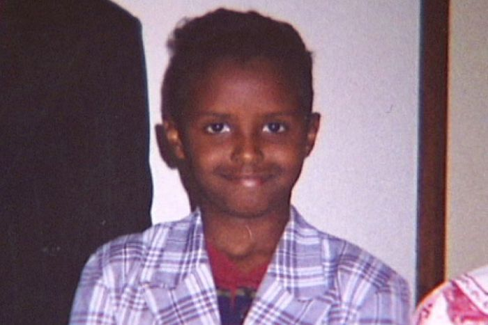 A smiling photo of  Yacqub Khayre as a young boy.