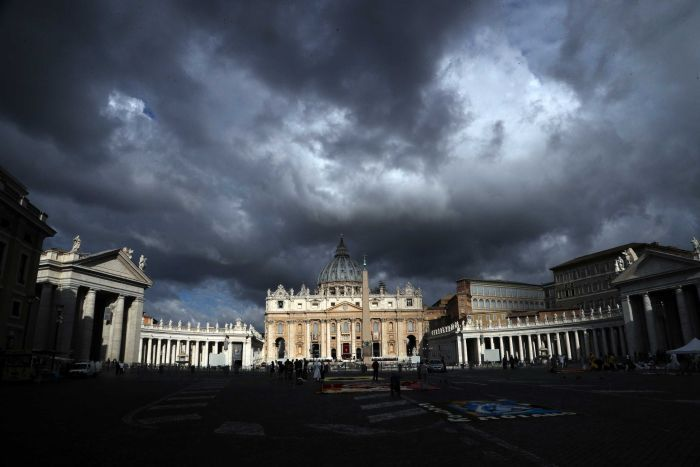 Clouds hang over St Peter's Basilica at the Vatican.