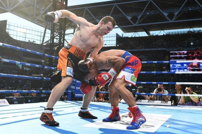 Jeff Horn (L) beat Manny Pacquiao to win the WBO welterweight title in Brisbane.
