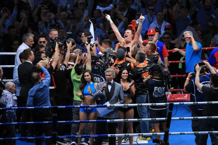 Jeff Horn celebrates his win over Manny Pacquiao to become WBO welterweight champion at Lang Park.