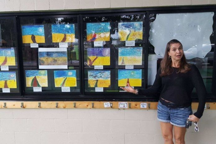 Lindsey Maasdorp with prep student examples of Vincent Van Gogh Wheat Fields