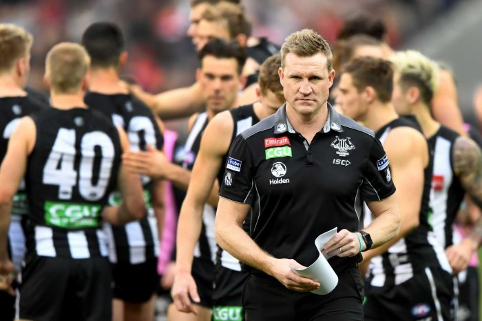 Collingwood coach Nathan Buckley walks off the ground during the match with Essendon at the MCG