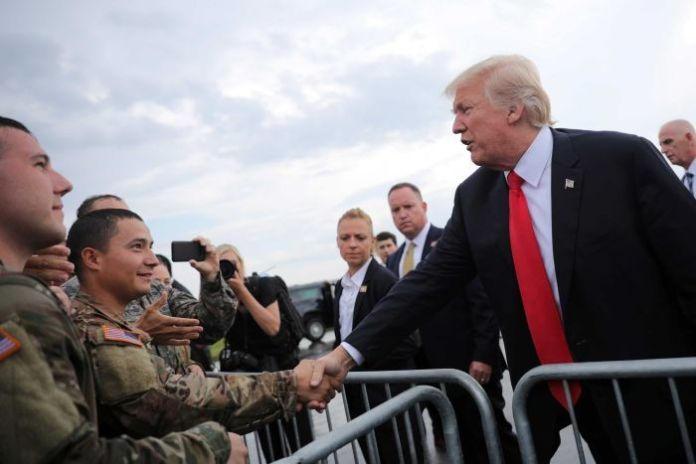 Donald Trump shakes hands with members of the military as he arrives at Raleigh County Memorial Airport in Beaver, West Virginia