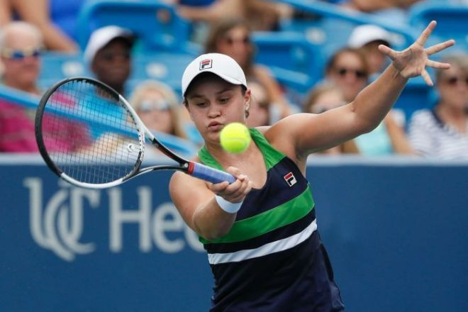 Ash Barty concentrates to return a serve on the forehand.