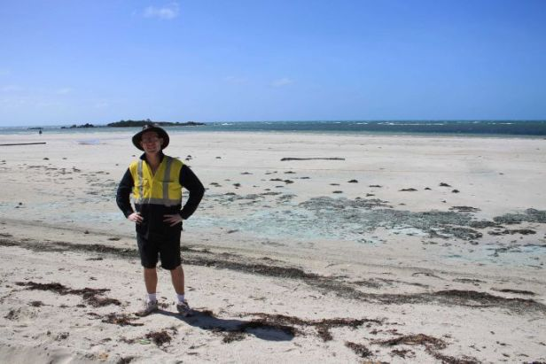 Mathew Townsend stands for a photo on Chilli Beach